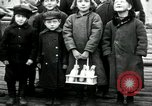 Image of Russian children receive coins Archangel Russia, 1918, second 8 stock footage video 65675029276