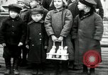 Image of Russian children receive coins Archangel Russia, 1918, second 10 stock footage video 65675029276
