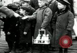 Image of Russian children receive coins Archangel Russia, 1918, second 12 stock footage video 65675029276