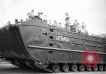 Image of amphibious vehicle LVT(U)X2 Goliath Seattle Washington USA, 1958, second 4 stock footage video 65675029304