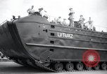 Image of amphibious vehicle LVT(U)X2 Goliath Seattle Washington USA, 1958, second 5 stock footage video 65675029304