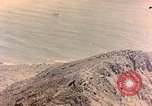 Image of volcano crater Iwo Jima, 1945, second 1 stock footage video 65675029314
