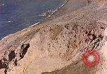 Image of volcano crater Iwo Jima, 1945, second 10 stock footage video 65675029314