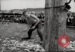 Image of tree-chopping and sawing contests Bavaria Germany, 1967, second 10 stock footage video 65675029474