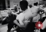 Image of School racial integration street fights Little Rock Arkansas USA, 1957, second 5 stock footage video 65675029483