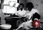 Image of Negro dentist Little Rock Arkansas USA, 1963, second 2 stock footage video 65675029491