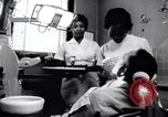 Image of Negro dentist Little Rock Arkansas USA, 1963, second 4 stock footage video 65675029491