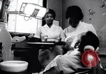 Image of Negro dentist Little Rock Arkansas USA, 1963, second 5 stock footage video 65675029491