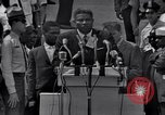 Image of Actor Ossie Davis introducing Burt Lancaster Washington DC, 1963, second 3 stock footage video 65675029518