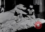 Image of machines iron bed sheets United States USA, 1931, second 9 stock footage video 65675029574