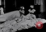 Image of machines iron bed sheets United States USA, 1931, second 10 stock footage video 65675029574