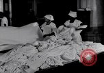 Image of machines iron bed sheets United States USA, 1931, second 11 stock footage video 65675029574