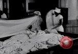 Image of machines iron bed sheets United States USA, 1931, second 12 stock footage video 65675029574