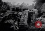 Image of British Mark IV (female) tank with hitchhikers France, 1916, second 9 stock footage video 65675029642