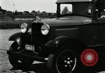 Image of Ford stake bed truck is demonstrated in operation United States USA, 1932, second 8 stock footage video 65675029688