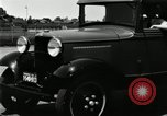 Image of Ford stake bed truck is demonstrated in operation United States USA, 1932, second 10 stock footage video 65675029688