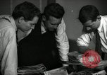 Image of Time journalists sort pictures New York City USA, 1939, second 2 stock footage video 65675029699