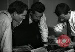 Image of Time journalists sort pictures New York City USA, 1939, second 4 stock footage video 65675029699