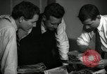 Image of Time journalists sort pictures New York City USA, 1939, second 5 stock footage video 65675029699