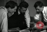Image of Time journalists sort pictures New York City USA, 1939, second 6 stock footage video 65675029699