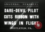 Image of stunt pilot Bustleton Pennsylvania USA, 1936, second 1 stock footage video 65675029724