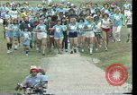 Image of torch marathon race Houston Texas USA, 1977, second 2 stock footage video 65675029727