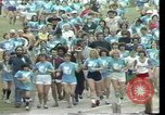 Image of torch marathon race Houston Texas USA, 1977, second 8 stock footage video 65675029727