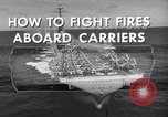 Image of aircraft carrier fire fighting United States USA, 1960, second 2 stock footage video 65675029807