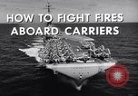 Image of aircraft carrier fire fighting United States USA, 1960, second 3 stock footage video 65675029807