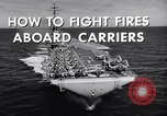 Image of aircraft carrier fire fighting United States USA, 1960, second 4 stock footage video 65675029807