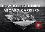 Image of aircraft carrier fire fighting United States USA, 1960, second 5 stock footage video 65675029807