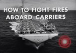 Image of aircraft carrier fire fighting United States USA, 1960, second 7 stock footage video 65675029807