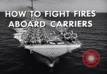 Image of aircraft carrier fire fighting United States USA, 1960, second 8 stock footage video 65675029807