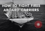 Image of aircraft carrier fire fighting United States USA, 1960, second 10 stock footage video 65675029807