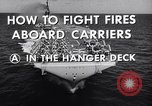 Image of aircraft carrier fire fighting United States USA, 1960, second 11 stock footage video 65675029807