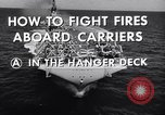 Image of aircraft carrier fire fighting United States USA, 1960, second 12 stock footage video 65675029807