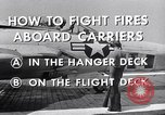 Image of controlling deck fire United States USA, 1960, second 4 stock footage video 65675029808