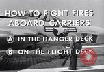 Image of controlling deck fire United States USA, 1960, second 5 stock footage video 65675029808