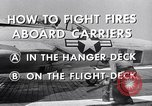 Image of controlling deck fire United States USA, 1960, second 6 stock footage video 65675029808