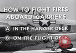 Image of controlling deck fire United States USA, 1960, second 7 stock footage video 65675029808