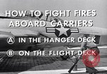 Image of controlling deck fire United States USA, 1960, second 9 stock footage video 65675029808