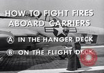 Image of controlling deck fire United States USA, 1960, second 10 stock footage video 65675029808