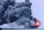 Image of burning American aircraft carrier Japan, 1945, second 12 stock footage video 65675029824