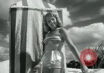 Image of metallic swimsuits Florida United States USA, 1948, second 7 stock footage video 65675029887