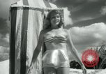 Image of metallic swimsuits Florida United States USA, 1948, second 8 stock footage video 65675029887