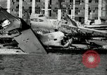 Image of wrecked planes Pearl Harbor Hawaii, 1941, second 13 stock footage video 65675029980