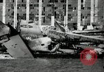 Image of wrecked planes Pearl Harbor Hawaii, 1941, second 14 stock footage video 65675029980
