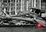 Image of wrecked planes Pearl Harbor Hawaii, 1941, second 16 stock footage video 65675029980