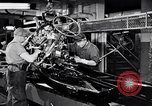 Image of assemble car parts Michigan United States USA, 1938, second 7 stock footage video 65675029998