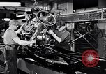 Image of assemble car parts Michigan United States USA, 1938, second 8 stock footage video 65675029998